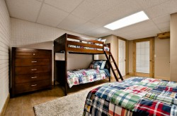 Lower level bunk room with 1 full and 1 bunk bed