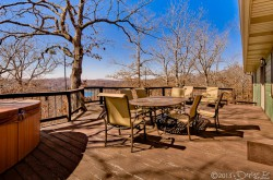 Back deck with deck furniture, outdoor spa, and gas BBQ grill
